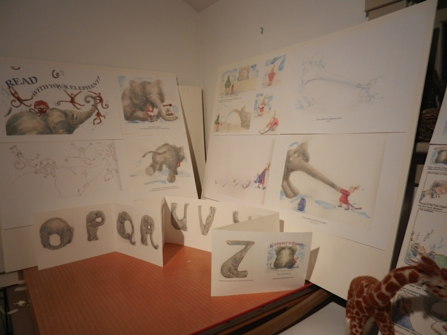 Getting ready...Brooks Memorial Library Art Show...Elephant art on boards in studio-3